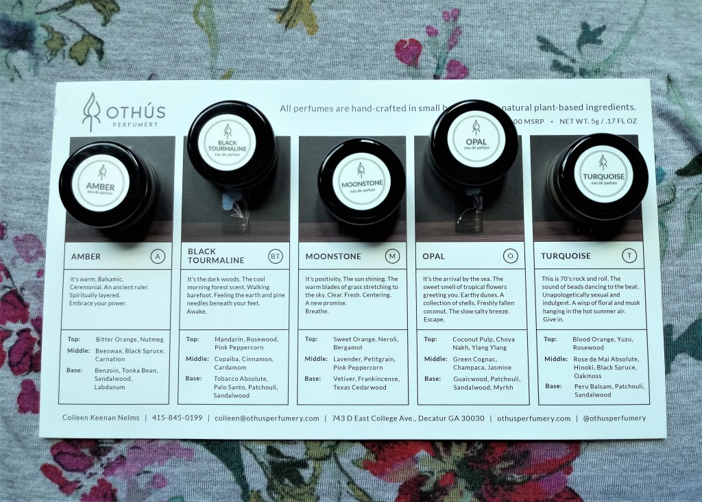 The five solid samples set on the information card which lists notes for each scent.