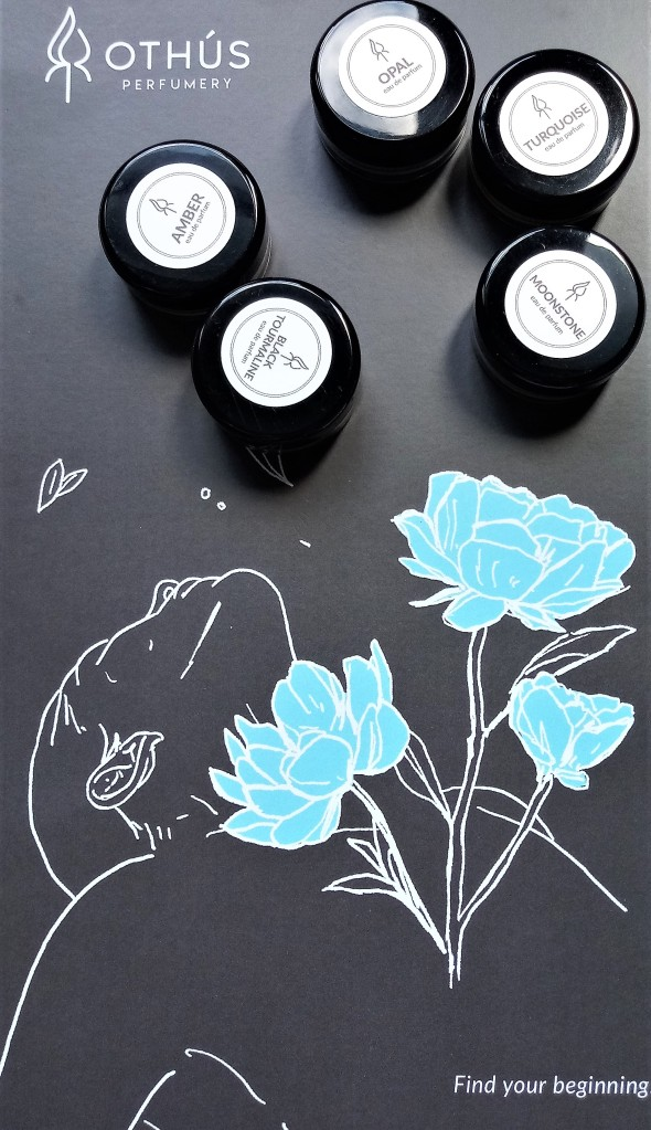 The five fragrances against the Othus Perfumery brand image, of a woman holding blue flowers against a black background