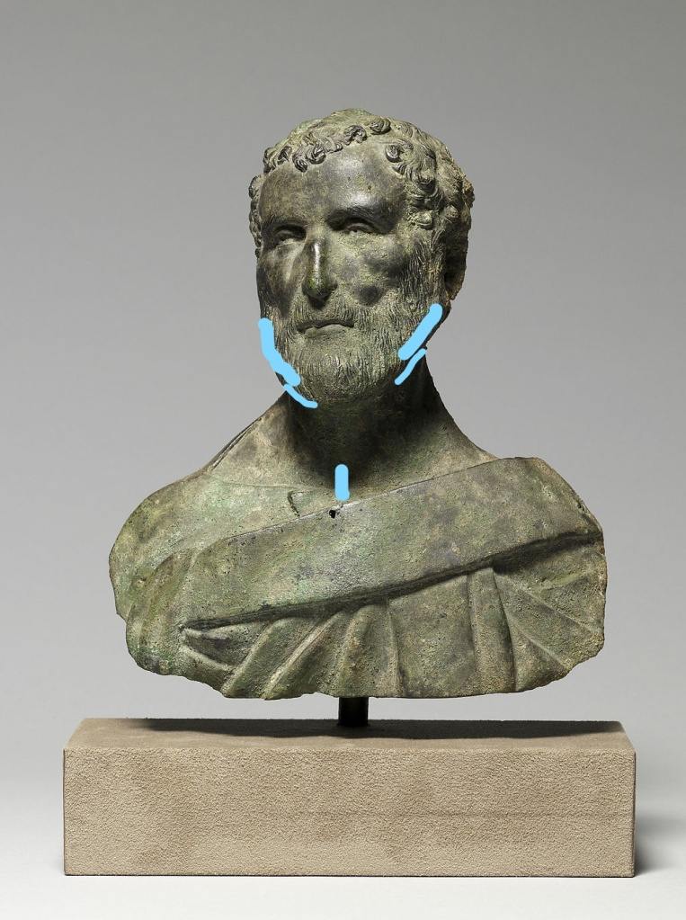 Bust of a Roman gentleman, with a full beard, with blue annotations showing where to apply solid fragrance in the beard