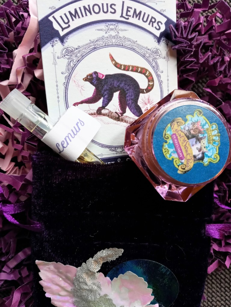 Luminous Lemurs solid perfume, a sample of the liquid perfume, the information card and the decorated velvet pouch they arrived in