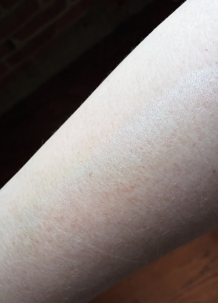 a pale-skinned woman's arm with a visible shimmery white stripe