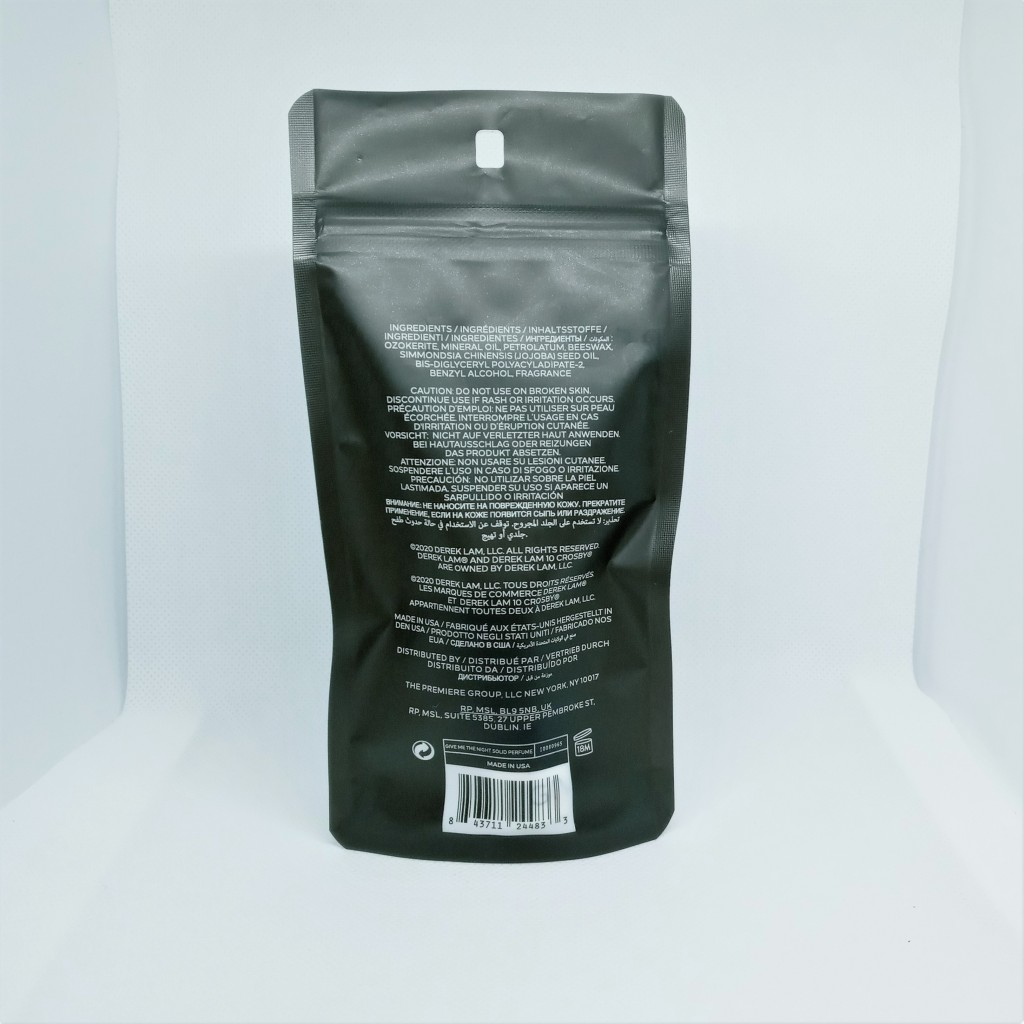 The back of the Give Me the Night Perfume bag, dark gray with white letters