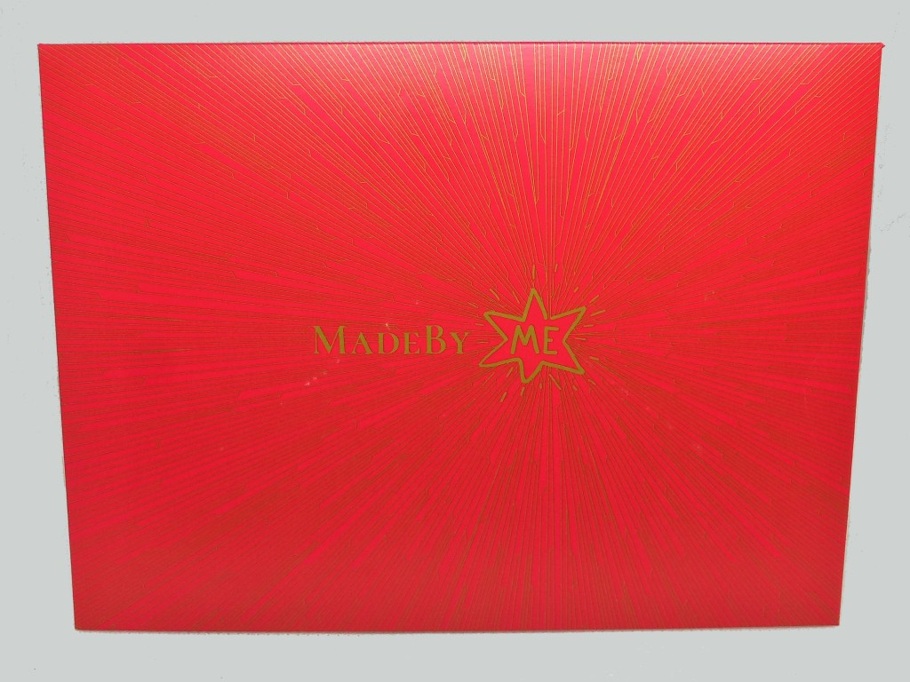 The red Made By Me Sample Kit envelope, with a gold star and gold text