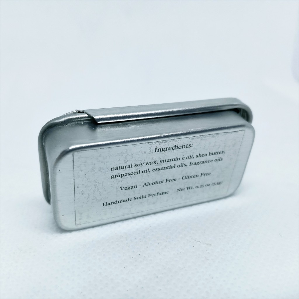 The back of the Irene perfume tin, showing the list of ingredients