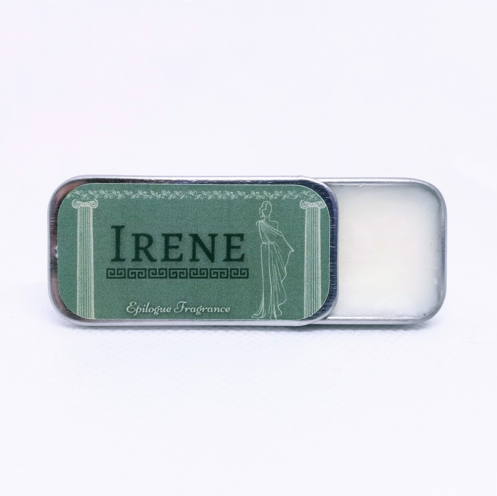 The Irene perfume tin with the top partially open, to show the solid perfume it contains