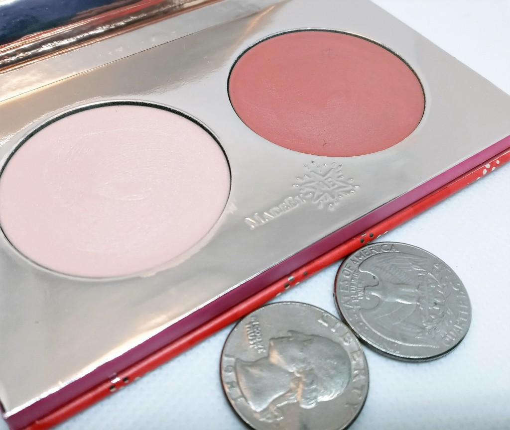 A close-up photo of the open palette next to two US quarters, to show scale