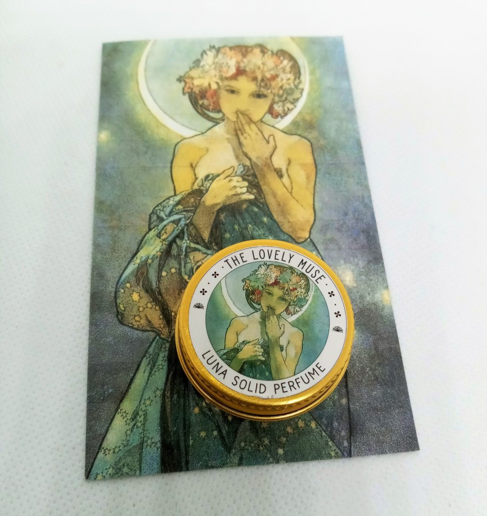 The Luna tin atop its product card featuring the artwork