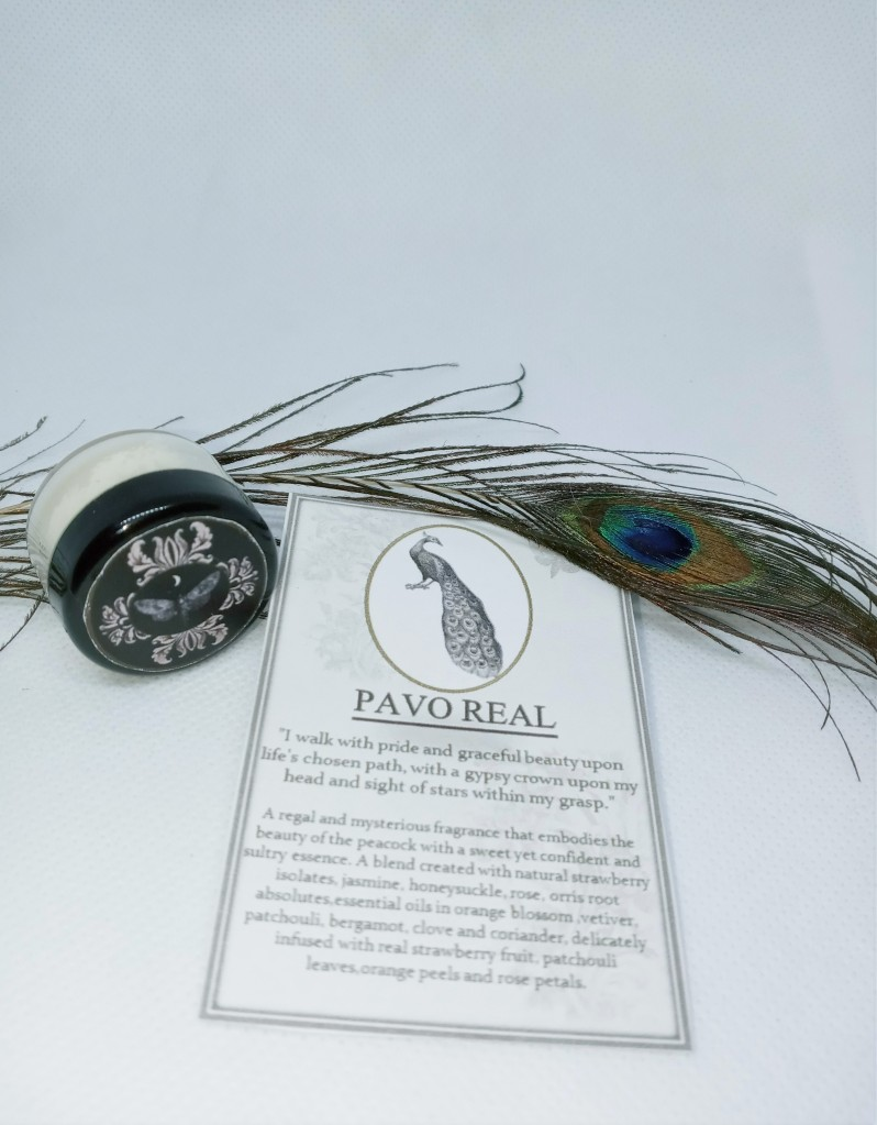 Pavo Real next to its product card, adorned with a fake peacock feather